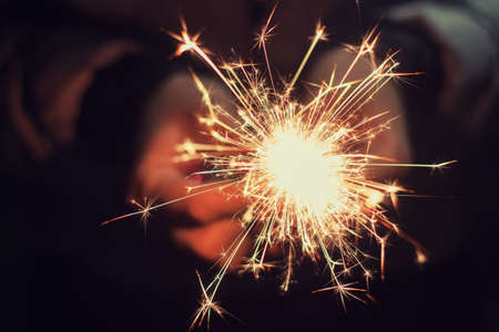 sparklet: beautiful bright celebratory sparkler in woman hands