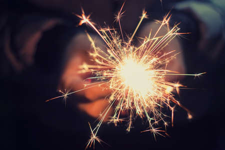 sparklet: bright festive Christmas sparkler in hand toning