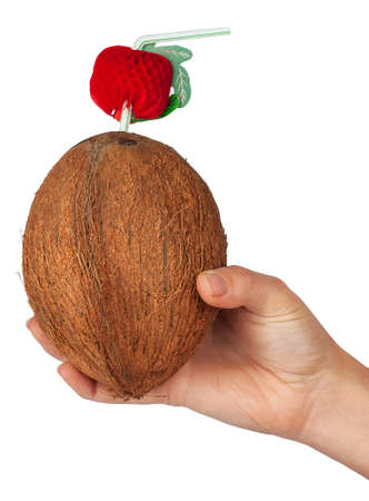 womans: Cocktail in a coconut with a straw in a womans hand  isolate on white background Stock Photo