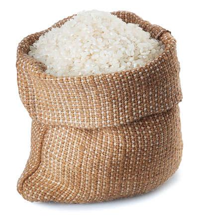 White rice in burlap sack isolated on white background Stockfoto