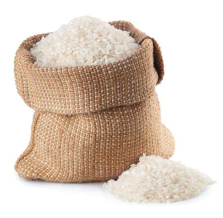 rijst in jutezak op witte achtergrond wordt geïsoleerd die Stockfoto