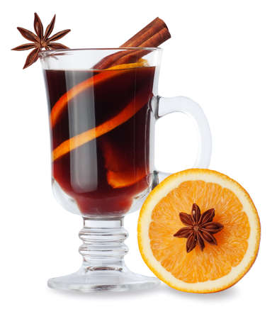 christmas perfume: mulled wine with spices in glass and orange isolated on white background