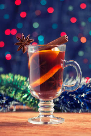 christmassy: Christmassy mulled wine with tinsel on a wooden table on bokeh background