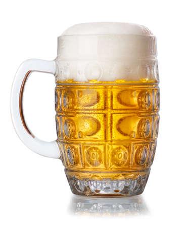 unbottled: mug of fresh unbottled beer with froth isolated on white background