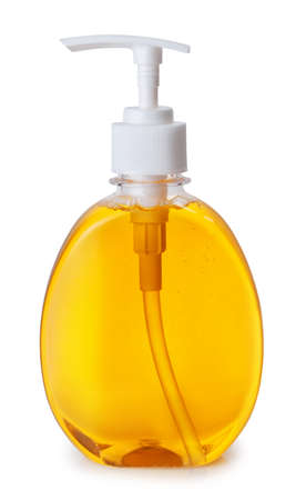 one plastic bottle with orange liquid soap with pump isolated on white background