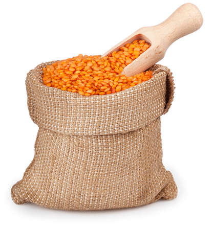 burlap bag: red lentils in burlap bag with wooden scoop isolated on white background