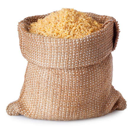 Bulgur or couscous in burlap bag isolated on white background