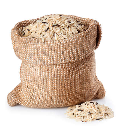 solated on white: wild and brown rice in sack bagi solated on white background Stock Photo