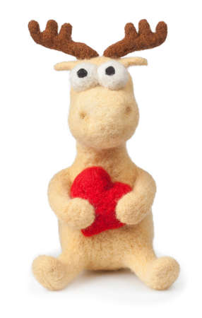 handmade toy of  felt deer with heart isolated on white background. Christmas  decoration deer. Soft toy
