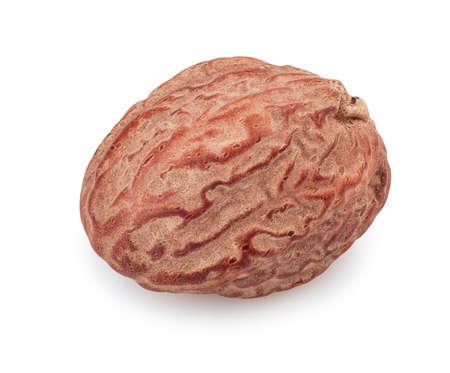nutmeg: Macro of nutmeg isolated on white background. Single nutmeg whole isolated on white background Stock Photo