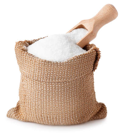 sugar with scoop in burlap sack isolated on white background. Stockfoto