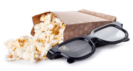 nack: popcorn in paper box with 3d movie glasses isolated on white background. Stock Photo