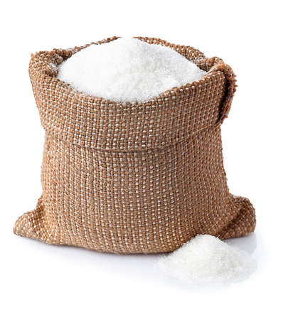 Sugar. Sugar in burlap sack isolated on white background. Full bag of sugar crystals closeup
