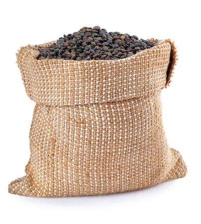 super food: black lentils in burlap bag isolated on white background. Black beluga lentils. Super food