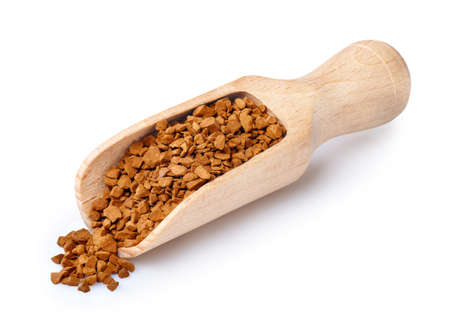 instant coffee in wooden scoop isolated on white background. Spoon of coffee crystals. Granulated coffee Stock Photo