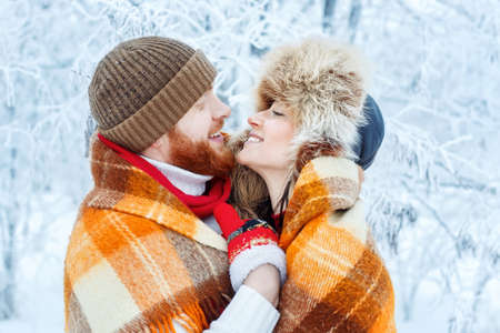 couple winter: couple hugging outdoors in winter