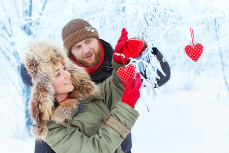 couple winter: young couple in winter forest Stock Photo