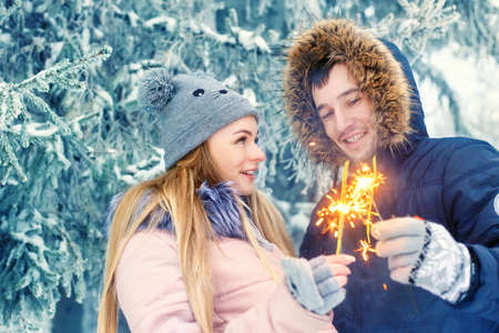 couple winter: couple with sparklers in winter