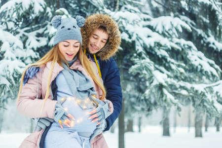 couple winter: pregnant couple in winter
