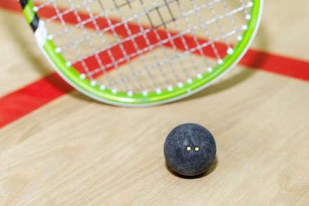 racquetball: squash racket and ball