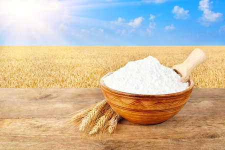 flour in bowl on nature background Stock Photo