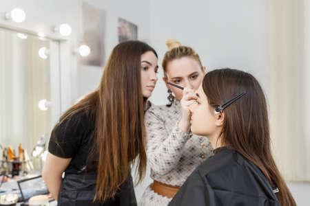 makeup artist in beauty studio