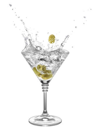 Alcohol cocktail with martini and olives in glass with splashes isolated on white background. Splash of martini from the falling green olives