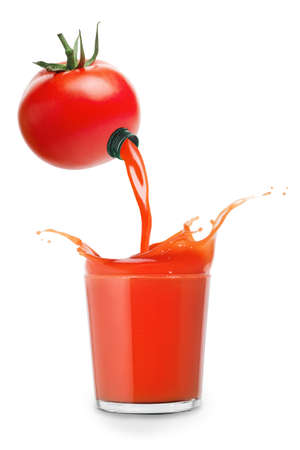 juice pours from tomato into glass