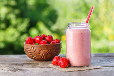 smoothie in jar with natural background