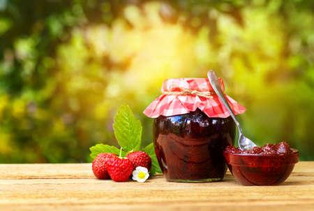 closed ribbon: strawberry jam on table Stock Photo