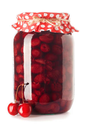 Glass jar of cherry jam