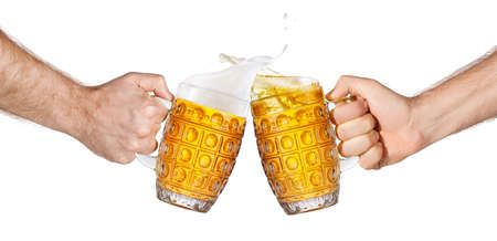 hands holding beer mugs making toast