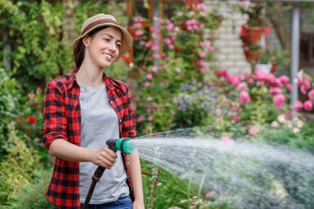 woman gardener watering garden Stock fotó