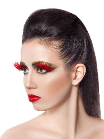 Beautiful woman with vivid creative makeup