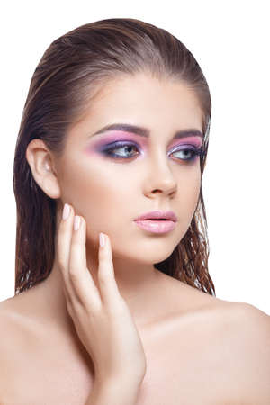 unblemished: young woman with perfect skin and pink makeup