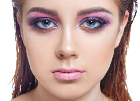 unblemished: Closeup portrait of girl with pink makeup Stock Photo