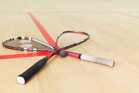 two squash rackets and ball 스톡 콘텐츠