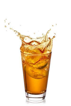 glass of splashing apple juice