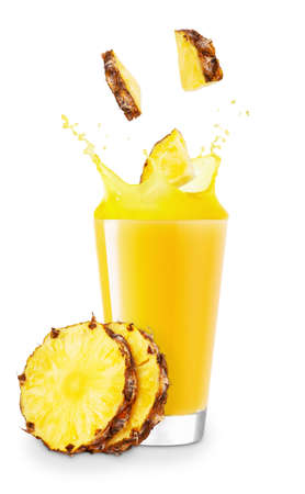 glass of splashing pineapple juice