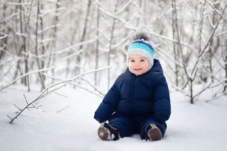 baby boy sitting on snow