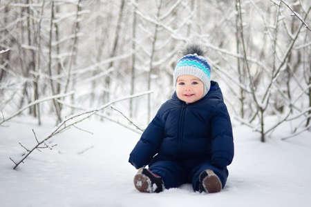 baby boy sitting on snow