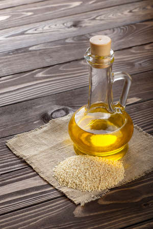 sesame oil in glass bottle Stock Photo