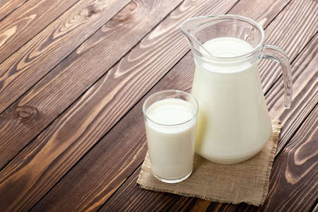 milk in glass and jug Imagens
