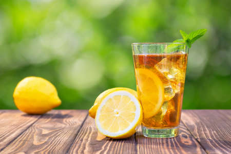 glass of ice tea on wooden table