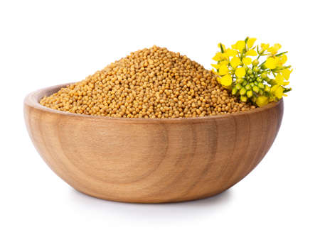 mustard seeds in wooden bowl Stock fotó