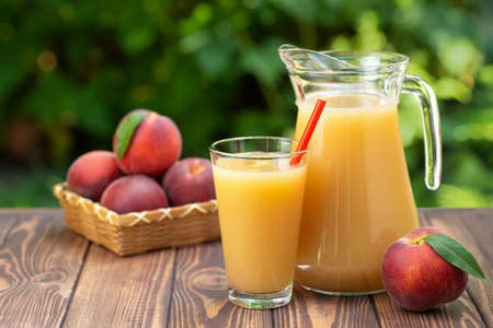 peach juice in glass and jug