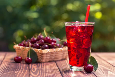 cherry juice or cocktail with ice in glass Stockfoto