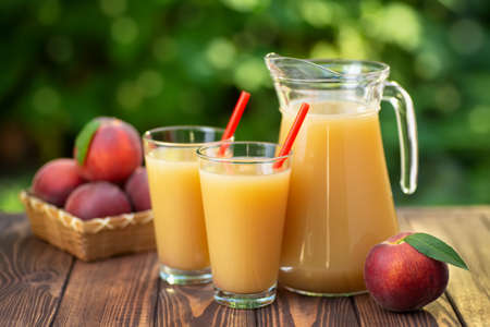 peach juice in glasses and jug