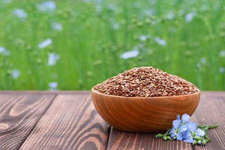 flax seeds in bowl Zdjęcie Seryjne - 129959704