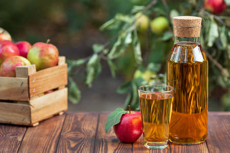apple juice in glass and bottle